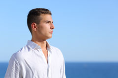 Handsome man looking at the horizon. With a blue sky in the background Royalty Free Stock Photography