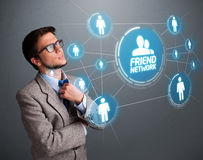 Handsome man looking at modern social network Stock Image