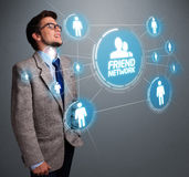Handsome man looking at modern social network Royalty Free Stock Photography