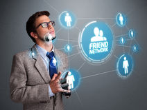 Handsome man looking at modern social network Royalty Free Stock Photo