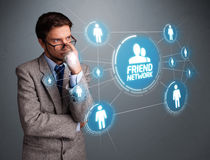 Handsome man looking at modern social network Stock Photo