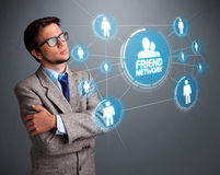Handsome man looking at modern social network Royalty Free Stock Photos