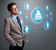Handsome man looking at modern social network. Handsome young man looking at modern social network Royalty Free Stock Images