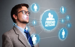 Handsome man looking at modern social network Stock Photos