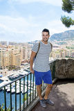 Handsome man looking at Monte Carlo harbor in Monaco. Azure coast. Royalty Free Stock Photography