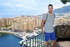 Handsome man looking at Monte Carlo harbor in Monaco. Azure coast. Royalty Free Stock Photos