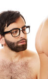 Handsome man looking on naked woman's ass. Stock Image