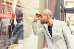 Handsome man looking for new clothes. Royalty Free Stock Images