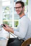 Handsome man looking at pictures on camera Royalty Free Stock Image