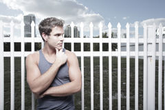 Handsome man looking to the side. Attractive young male glancing sideways with his hand on his chin Stock Photo
