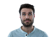 Handsome man looking up. Against white background Stock Photo