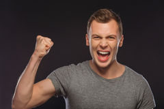 Handsome man looking victorious Royalty Free Stock Photography