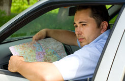 Handsome man lost at road. And using a map Stock Image