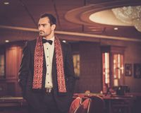 Handsome man  in luxury casino interior Royalty Free Stock Photography