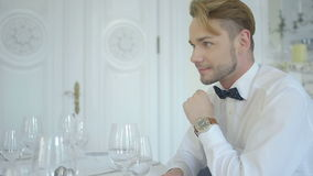 Handsome man in luxury restaurant interior during a date Stock Photos