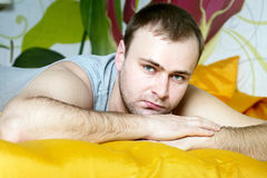 Handsome man lying in bed Royalty Free Stock Images