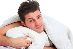 Handsome man lying in bed Royalty Free Stock Photography