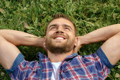 Handsome man lying on the grass Royalty Free Stock Photo