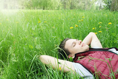 Handsome man lying on the grass Royalty Free Stock Image