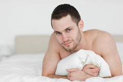 Handsome man lying on his belly Royalty Free Stock Photos