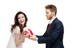 Handsome man makes present to his girlfriend Stock Images
