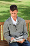 Handsome man making his crossword Royalty Free Stock Image