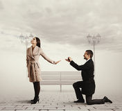 Handsome man making proposal of marriage Royalty Free Stock Photo