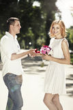 Handsome man making propose to girlfriend outdoors. Royalty Free Stock Images