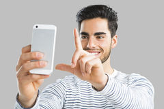 Handsome man making a selfie Stock Photos