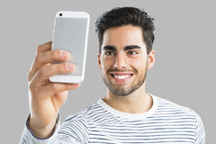Handsome man making a selfie Royalty Free Stock Image