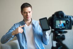 Handsome man making video blog. Stock Photos