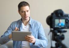 Handsome man making video blog. Stock Image