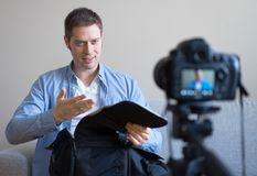 Handsome man making video blog. Royalty Free Stock Image