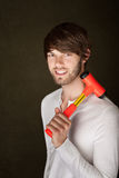 Handsome Man with Mallet. Smiling young man with red and yellow mallet Stock Photos