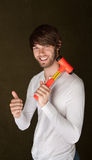 Handsome Man with Mallet. Handsome young man with mallet over his shoulder gives thumbs up Royalty Free Stock Images