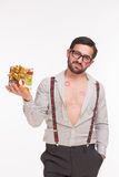 Handsome man with many kisses holding present Stock Images