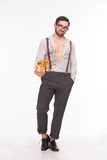 Handsome man with many kisses holding present Royalty Free Stock Photography