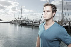 Handsome man by the marina Royalty Free Stock Photo