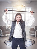 Handsome man in medieval clothes with cane Royalty Free Stock Photography