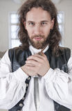 Handsome man in medieval clothes with dagger Stock Image