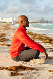 Handsome man meditating. Handsome young man meditating in South Beach in Miami Stock Photos