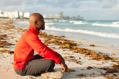 Handsome man meditating. Handsome young man meditating in South Beach in Miami Royalty Free Stock Photos