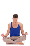 Handsome man meditating in lotus position Stock Image