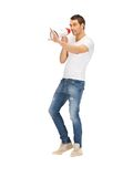 Handsome man with megaphone Royalty Free Stock Images