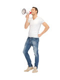 Handsome man with megaphone Stock Image