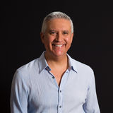 Handsome Man. Handsome middle age man on a black background Stock Photography