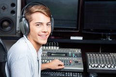 Handsome Man Mixing Audio In Recording Studio Royalty Free Stock Photo
