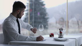 Handsome man with mobile phone in restaurant. Portrait of a handsome man using smartphone outdoors in restaurant stock video