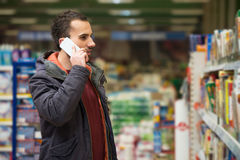 Handsome Man On Mobile Phone At Supermarket Stock Images