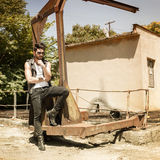 Handsome man model dressed punk, hipster posing dramatic in grun Royalty Free Stock Photography
